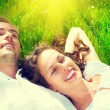Ouple relaxing on green grass — Stock Photo #80037082