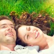 Ouple relaxing on green grass — Stock Photo #80037090
