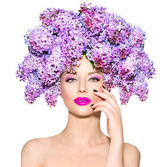 Girl with lilac flowers hairstyle — Stock Photo