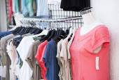 Row of hangers with clothes — Stock Photo