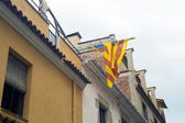 Banner of Catalonia on house wall — Stock Photo