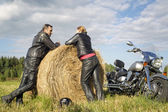 Couple of motorcyclists resting outside the city — Stock Photo