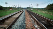Two railroad tracks receding far — Stock Photo