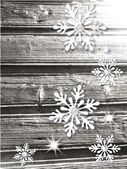 Christmas winter composition with snowflakes on the wooden background — Vector de stock