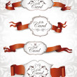 Set of elegant gift cards with red ribbons — Stock Vector #58506893