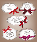 Set of elegant gift cards with silk ribbons — Stock Vector