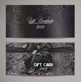Elegant black gift certificates with floral design — Stock Vector