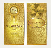 Elegant gold gift certificates with silk ribbons and floral design — Stock Vector