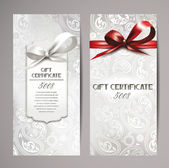Elegant white gift certificates with silk ribbons and floral background — Stock Vector
