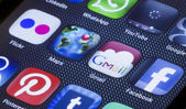 BELGRADE - JULY 05, 2014 Popular social media icons google maps gmail and other on smart phone screen close up — Stock Photo