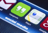 BELGRADE - JULY 11, 2014 Popular social media icons hangouts google maps and other on smart phone screen close up — Stock Photo