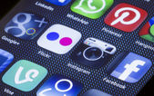 BELGRADE - JULY 05, 2014 Popular social media icons instagram flickr and other on smart phone screen close up — Stock Photo