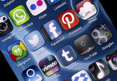 BELGRADE - JUNE 30, 2014 Popular social media icons Twitter, Facebook and other on smart phone screen — Stock Photo