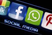 BELGRADE - SEPTEMBER 09, 2014 Social media icons Facebook and Whatsapp on smart phone screen close up — Stock Photo