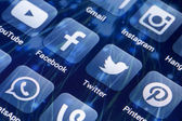 BELGRADE - MAY 28, 2014 Social media icons Facebook, Twitter and other on smart phone screen — Stock Photo