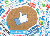 BELGRADE - JUNE 17, 2014 Social media website logos Facebook Twitter and other printed on paper with like icon on cork bulletin board — Stock Photo