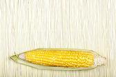 Corn on bamboo mat — Stock Photo