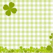 Green checkered pattern with clover — Stock Vector
