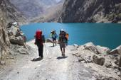 Group of backpackers hiking in high mountains of central Asia, T — Stock Photo