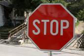 Red stop sign on a stone road — Stock Photo