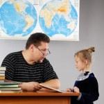 Teacher and schoolgirl little girl. The lesson in elementary school — Stock Photo #83701630
