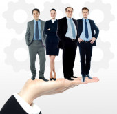 Business people standing on palm — Foto Stock