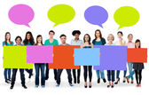 Diverse people holding colorful boards — Stock Photo