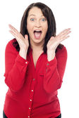 Woman holding face in astonishment — Stock Photo