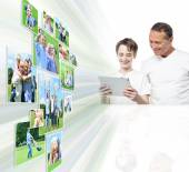 Father and son reviewing image — Stock Photo