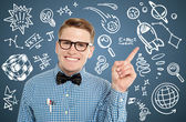 Nerd guy pointing out to set of icons — Stock Photo