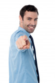 Businessperson pointing towards camera — Stock Photo