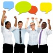 Business executives with colorful speech bubbles — Stock Photo #55992409