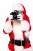 Santa claus taking photos — ストック写真