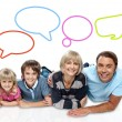 Smiling family with speech bubbles — Stock Photo #58408561