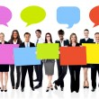 Business people with boards and speech bubbles — Stock Photo #58409311