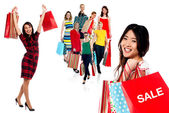 Women with colorful shopping bags — Stock Photo