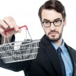 Businessman holding small shopping cart — Stock Photo #62304027