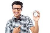 Man showing a alarm clock — Stock Photo