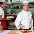 Chef preparing the pizza base — Stock Photo #67089081