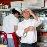 Chef makes the pizza dough — Stock Photo #67089111