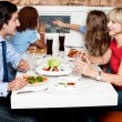 Family eating together in restaurant — Stock Photo #67089117