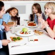 Family eating together in restaurant — Stock Photo #67089139