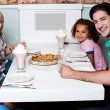 Family together in a restaurant — Stock Photo #67089209
