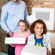 Girls and father with pizza boxes — Stock Photo #67089221
