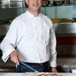 Chef with prepared pizza dough — Stock Photo #67089239