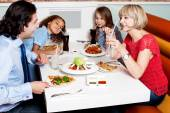 Family eating together in restaurant — Stock Photo