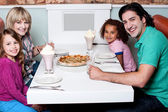 Family together in a restaurant — Stock Photo