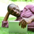 Man lying on lawn with tablet — ストック写真 #70222519