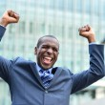 Businessman celebrating his success — Stock Photo #70222605