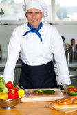 Young male chef posing — Stock Photo